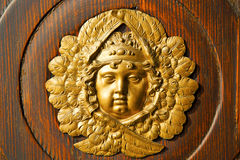 Gold face  house  door     in italy  lombardy   column Royalty Free Stock Photo