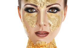Gold face make-up stock photo