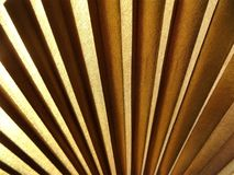 Gold fan texture. Gold color fan light and shade texture stock photography