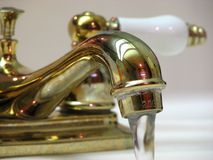 Gold Faucet Stock Photo