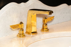 Gold faucet in bathroom Royalty Free Stock Photography