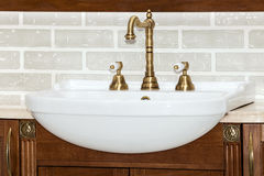 Gold faucet in bathroom Royalty Free Stock Photos
