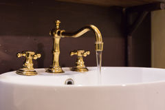 Gold faucet and washbasin design Royalty Free Stock Photos