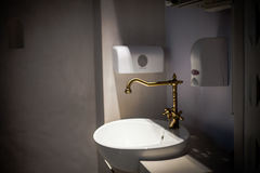 Gold faucet with white sink | bathroom interior luxury design Stock Images
