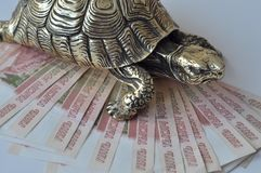 Gold feng-shui turtles with russian rubles royalty free stock photo