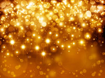 Gold festive background. Gold festive fantasy, bokeh background with stars Royalty Free Stock Photos