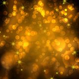 Gold festive bokeh background. Abstract gold festive background with bokeh effect Royalty Free Stock Images