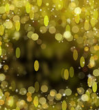 Gold Festive Christmas background. Elegant abstract background with bokeh defocused lights and stars Stock Photography