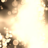 Gold Festive Christmas background. Elegant abstract background with bokeh defocused lights and stars Stock Photo