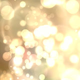 Gold Festive Christmas background. Elegant abstract background with bokeh defocused lights and stars Royalty Free Stock Photos