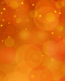 Gold Festive Christmas background. Elegant abstract background orange bokeh Royalty Free Stock Photos