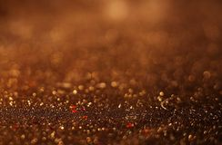 Gold Festive Christmas background. Elegant abstract background with bokeh defocused lights and stars Royalty Free Stock Photography