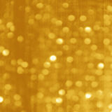 Gold Festive Christmas background. Gold Luxury  Festive Christmas background. Elegant abstract background with bokeh defocused lights and stars Stock Photography