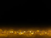 Gold Festive Christmas elegant abstract background with bokeh lights. Royalty Free Stock Photos
