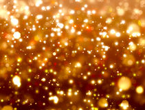 Gold festive fantasy. Beautiful festive fantasy,background bokeh with stars Royalty Free Stock Image
