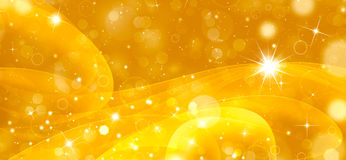 Gold festive fantasy. Shining festive golden background with stars Stock Photo