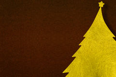 Gold fiber Christmas tree with paper dark brown background. Christmas background concept Stock Photography