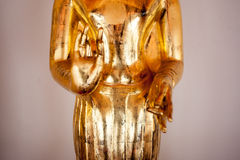 Gold figure of Buddha in temple Bangkok, Thailand. Close-up Royalty Free Stock Photo