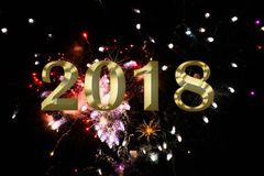 Gold figures 2018 on the background of the festive fireworks. Image of gold figures 2018 on the background of the festive fireworks Royalty Free Stock Photos