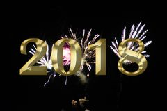 Gold figures 2018 on the background of the festive fireworks. Image of gold figures 2018 on the background of the festive fireworks Stock Photography