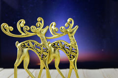 Gold figures of deer in the night sky Stock Photos