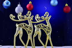 The gold figures of deer in the night sky and Christmas ornament Royalty Free Stock Image