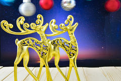 The gold figures of deer in the night sky and Christmas ornament Stock Photo