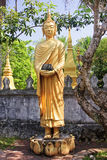 Gold figures of monks in Luang Prabang Stock Photo