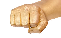 Gold fingers clenched in a fist Stock Images