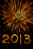 Gold fireworks and 2013 in sparkler writing Stock Photo