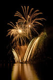 Gold fireworks on lake Stock Photo