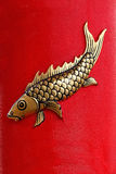 Gold Fish on Red Background Stock Photo