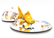 Gold fish on a restaurant cloche Stock Image