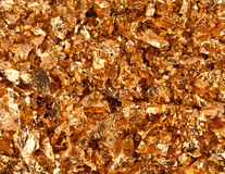 Gold flakes. Real 24k gold flakes background Royalty Free Stock Image