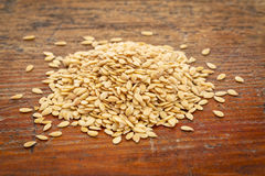 Gold flax seeds Royalty Free Stock Photos