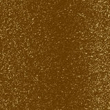 Gold flecks on a brown background Stock Image