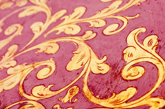 Gold flourish design. Red background. Royalty Free Stock Photography