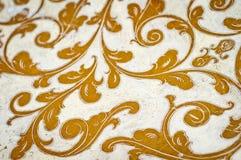 Gold flourish design. White background. Royalty Free Stock Photos