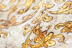 Gold flourish design. White background stock image