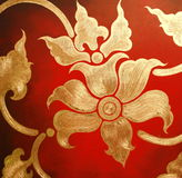 Gold Flower On Red Wall Stock Photo