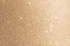 Gold Foil Background Or Texture Glitter Sparkle Blurred Lights. Abstract Paillette Luxury Shiny Wallpaper. Merry Christmas And Happy New Year Card Design stock photos