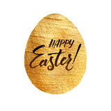 Gold Foil Calligraphy Happy Easter Greeting Card. Modern Brush Lettering. Gold Stroke Egg and Black Letters. Joyful wishes, holida Royalty Free Stock Photography