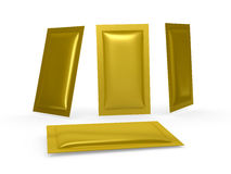 Gold foil heat sealed packet with clipping path. Gold foil  blank heat sealed packet  with clipping path. Packing  or wrapper for sweet, snack, milk bar, coffee Royalty Free Stock Photos
