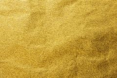 Gold foil leaf metallic wrapping paper shiny texture background.  stock photography