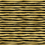Gold foil stripes on black background. Royalty Free Stock Photo