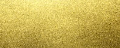Gold foil texture. Gold rough paper foil texture for metallic designs background and artworks stock photos