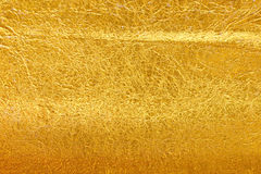 Gold foil texture. Shiny yellow leaf gold foil texture background Stock Photo