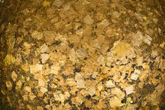 Gold foils pasted on the surface of Luuk Nimit round stones for. Buried in the ground to mark the sacred limits of a temple, for the consecration temple Royalty Free Stock Photo