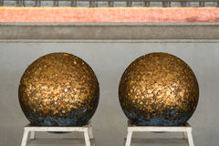 Gold foils pasted on the surface of Luuk Nimit round stones for. Buried in the ground to mark the sacred limits of a temple, for the consecration temple Stock Photography