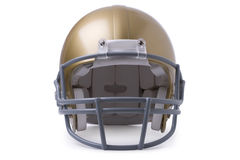 Gold football helmet isolated on white. Front view of a gold football helmet isolated on a white background Stock Image